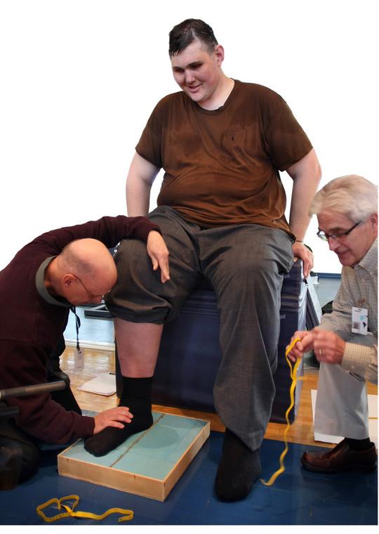 Igor Vovkovinsky during a foot measurement by Reebok experts