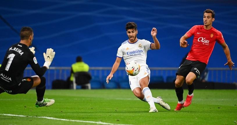 Marco Asensio scores a goal / AFP