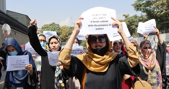 Afghanistan.  Women stand in front of the Republican Palace in Kabul