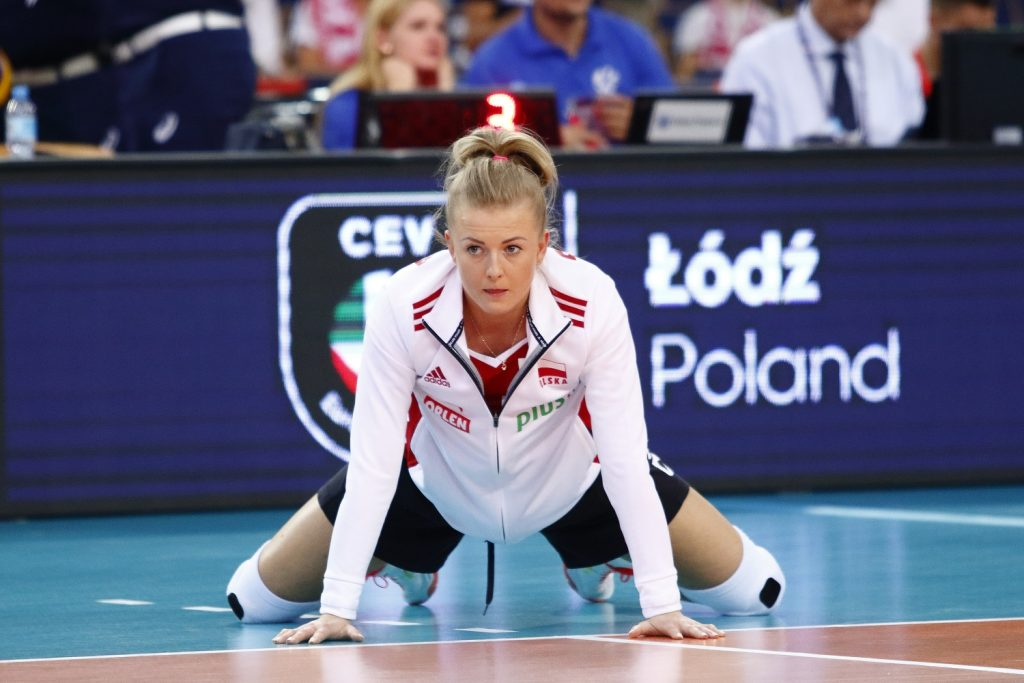 A leading Polish volleyball player, speaks powerfully about the team.  Accused of forging girls' signatures