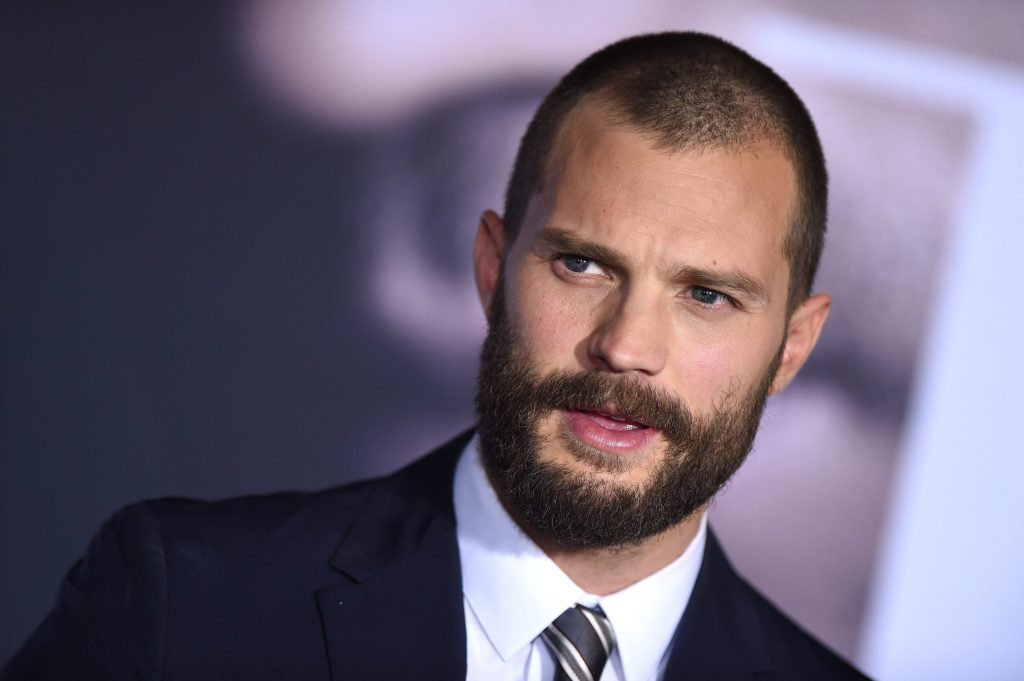 He plays the role of Christian Gray.  10 Interesting Facts About Jamie Dornan